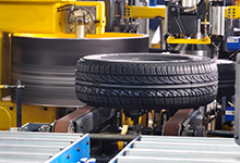 Tire being checked on quality uniformity by machine